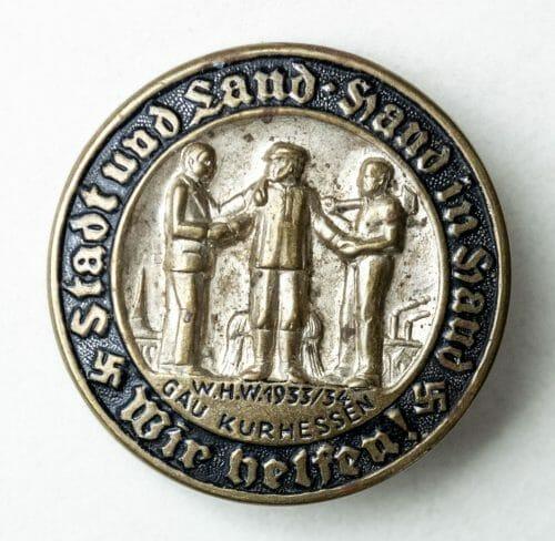 Gau Hurhessen badge: Stadt und Land, Hand in Hand, Wir Helfen