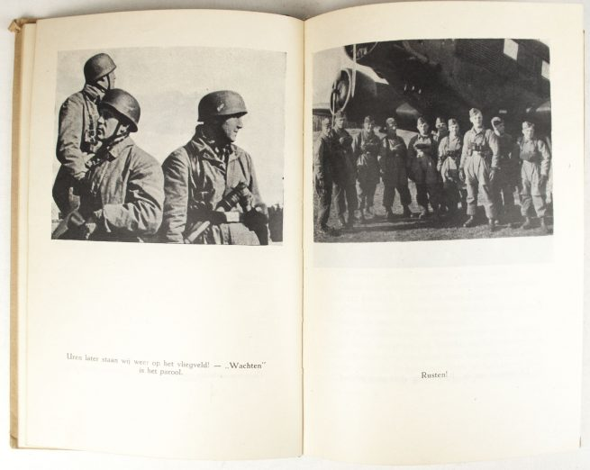 (NSB) H. Schmidt, Parachutisten grijpen in