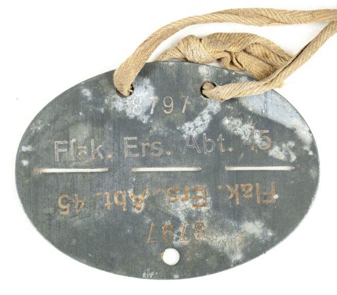 Flak erkennungsmarke / EKM Flak Ers. Abt. 45 (with original cord)