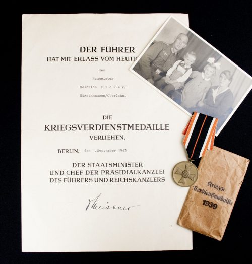 Kriegsverdienstmedaille (KVKm) + bag (by Josef Feix) + citation + photo