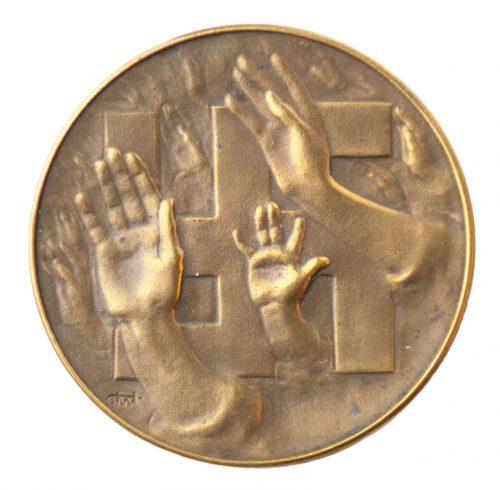 "Hitler / NSDAP propaganda badge with ""nazi saluting"" hands and swastika"
