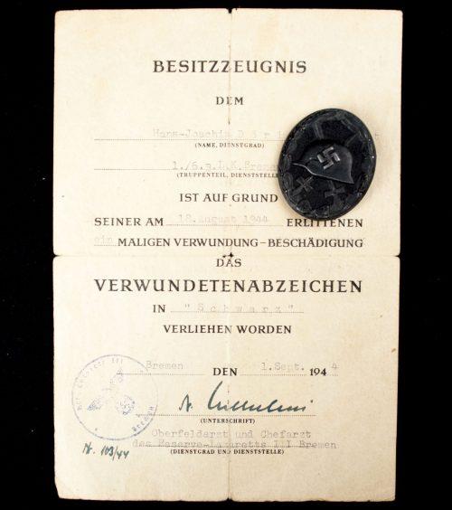 """Verwundetenabzeichen schwarz / Woundbadge black (maker """"93"""") + citation"""