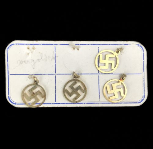 Small sampleboard with 4 swastika necklace hangers