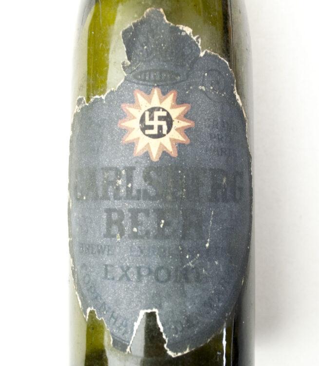 (Denmark) Carlsberg Beer Bottle pre-World War II with old style swastika label