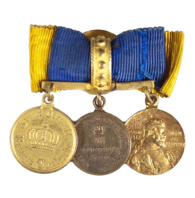 Miniature medals on buttonhole device (1871 Kriegsdenkmünze, Zentenaren medaille + Dienstauszeichnung)